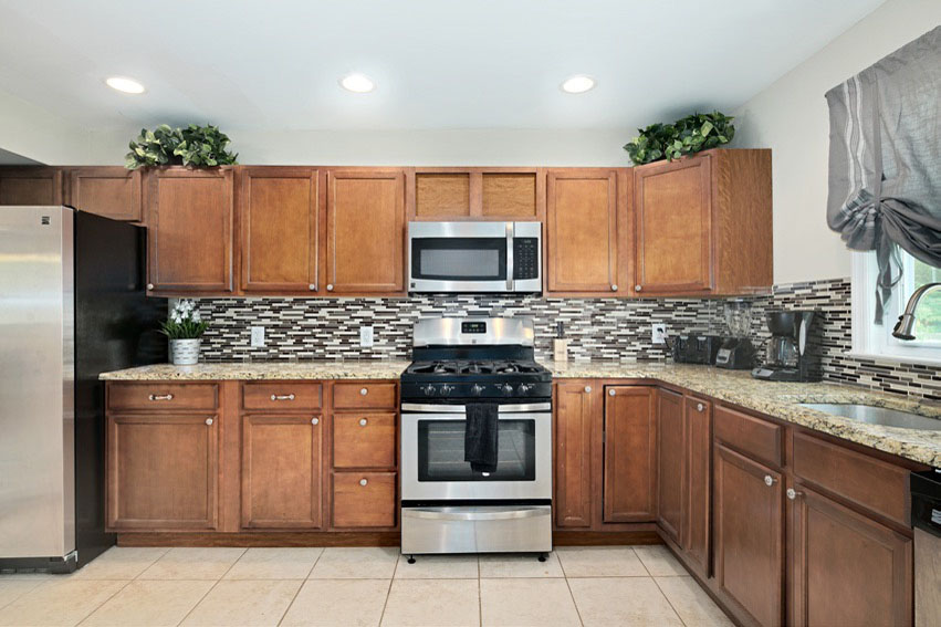 Full size updated kitchen with stainless appliances and coffee machine at updated Bathroom with shower at Hi Nella Sober Living Home for Men
